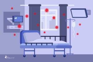 Cartoon image shows an empty hospital bed surrounded by red COVID particles