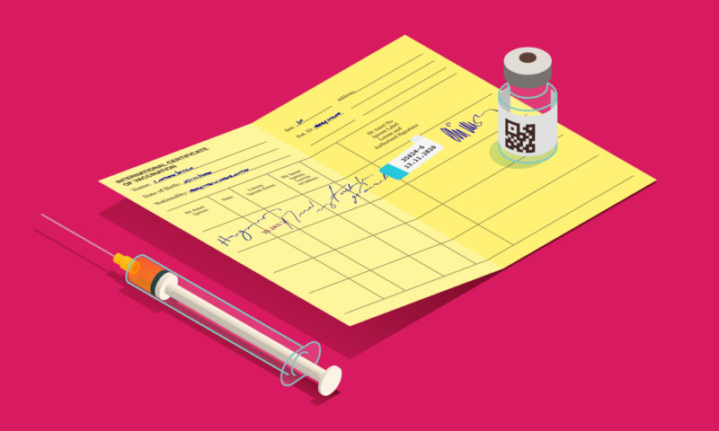 A COVID-19 syringe rests aside a COVID-19 vaccination card. On top of the card is a vial of the COVID-19 vaccine.