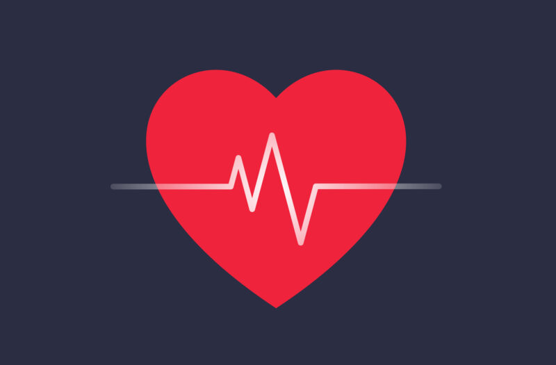 Red heart shape and heartbeat symbol, cardiogram, health care concept. Blue background.